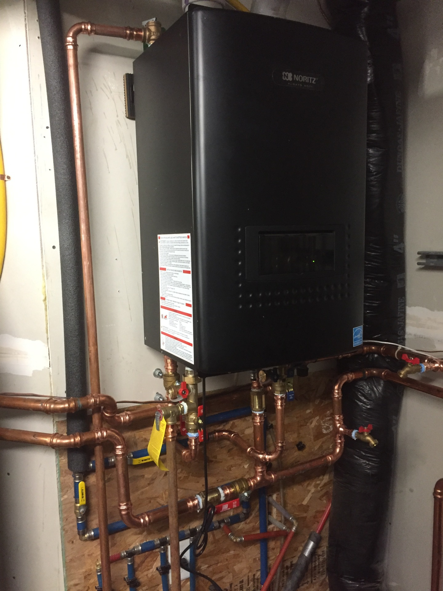 Noritz Combi on demand water heater and Waterfurnace backup