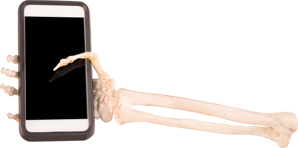 Smart phone in skeleton hand