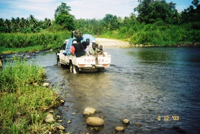By pickup truck, Bougainville, Papua New Guinea