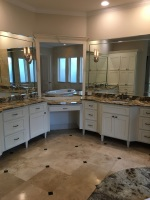 custom bathroom tile floor and cabinetry