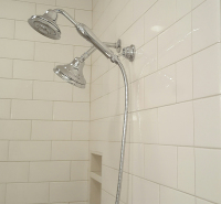 tile shower and chrome showerhead