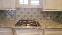 custom kitchen stove and backsplash