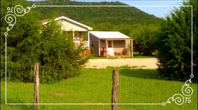 """<IMG SRC=""""ViewFromTheRoad.jpg"""" ALT=""""Sunflower Cottage and The Cave - The view as you approach Cedar Grove Retreat"""">"""