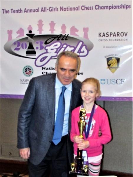 GM Gary Kasparov awards Alexis her trophy