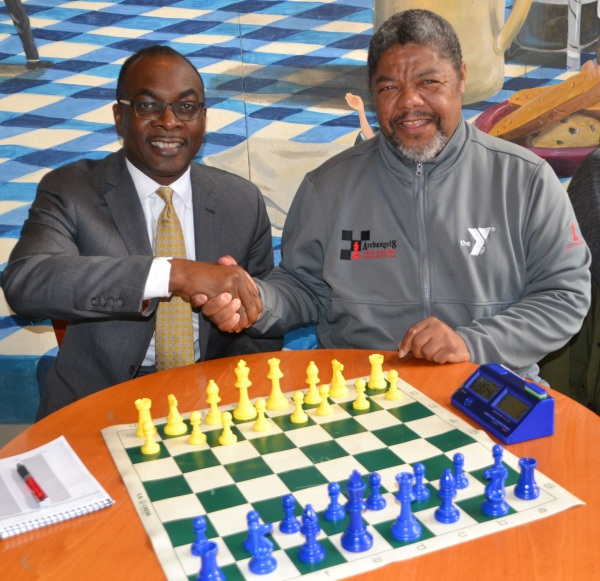 Mayor Brown receives a chess lesson from Coach