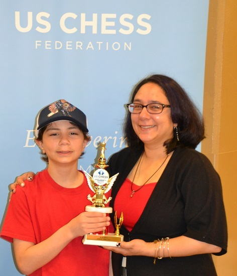 Tristan and Mom Keri, celebrating his National K-6 Blitz trophy!