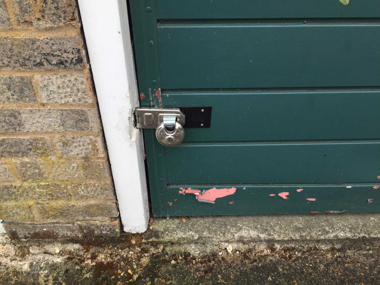 Garage door with padlock