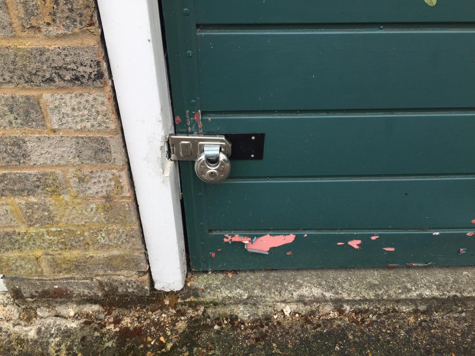 Garage door with padlock