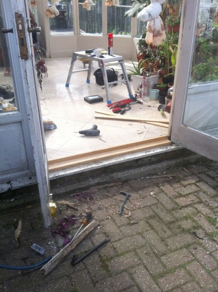 Temporary door threshold fitted