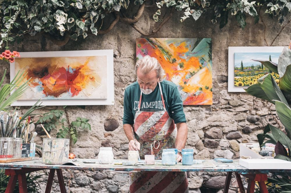 An artist working with paint to deliver custom art