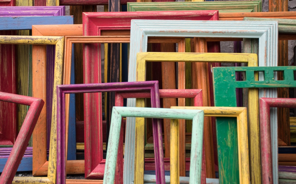 Colourful image frames made of wood