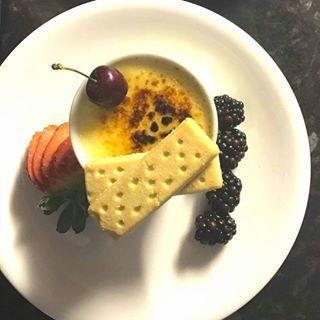 creme brulee with shortbread biscuit and seasonal berries