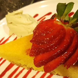 raspberry and rose polenta cake with ice cream and berry coulis
