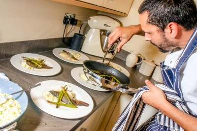 chef luis plating a dish