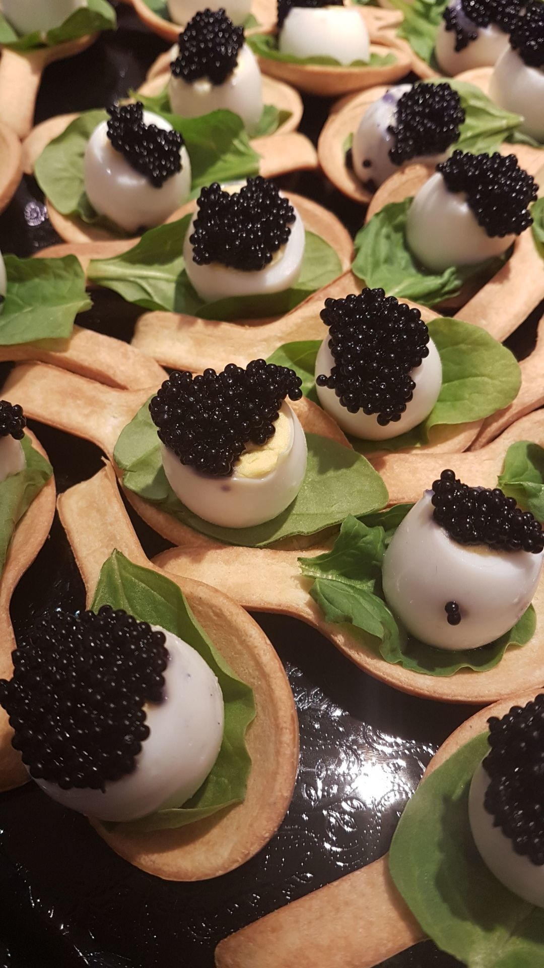 quail egg and caviar canape