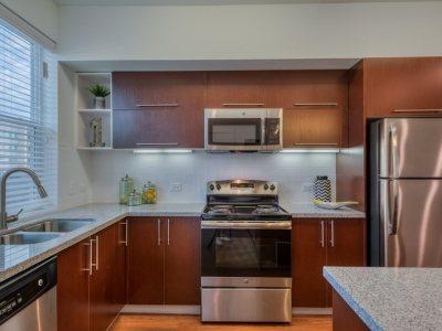 Designer Kitchens with Over-sized Islands  Front Loading Washer & Dryer