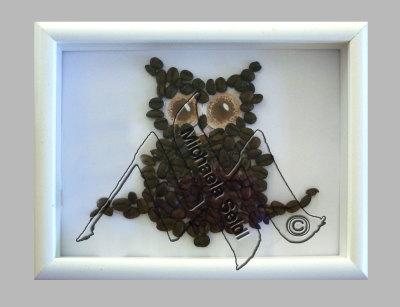 Coffee bean owl in frame
