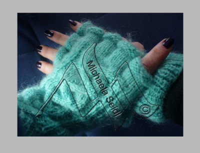 Knitted gloves with cable stitch