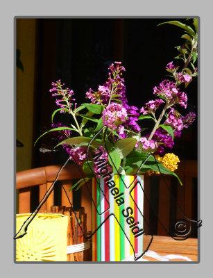 Flower vase embellished with straws