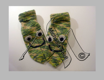 Knitted kid's socks with frog face
