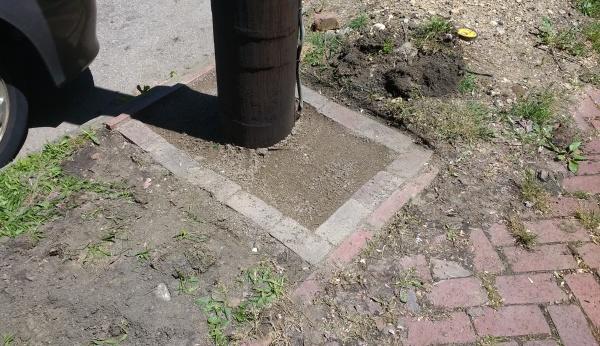 bricks surrounding pole