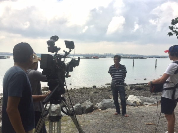 Filming a documentary on the importance of Singapore's mangroves
