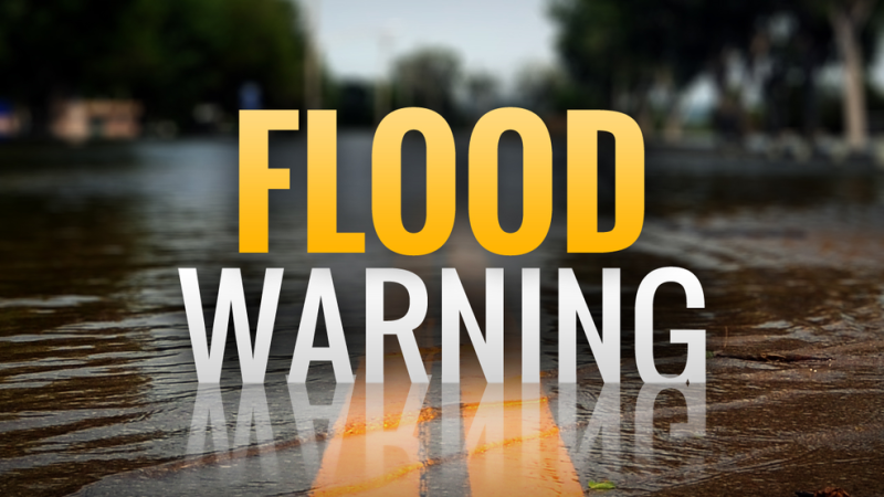 River cresting; flood warning continues