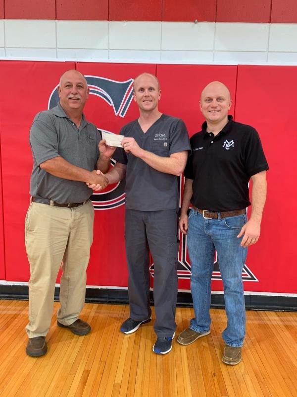 Dixon Family Dental donates security locks for Sacred Heart School