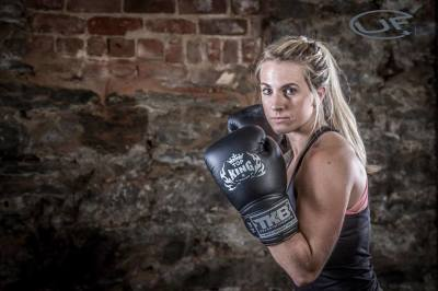 Underground Fitness woman with boxing gloves