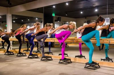 Pure Barre women doing barre exercises