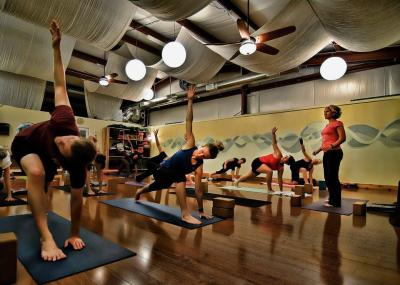 Asheville Community Yoga class of people doing yoga