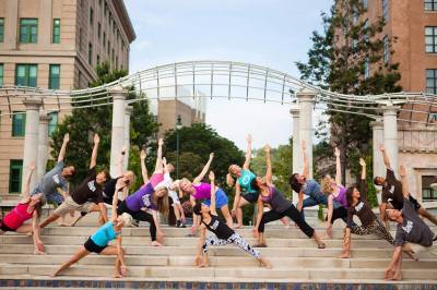 Hot Yoga Asheville group of people doing yoga downtown Asheville