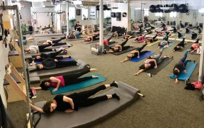 RISE authentic pilates group of people doing pilates in a studio