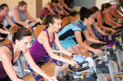 Asheville gyms, Women on spin bikes in group fitness class