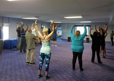 Learning the Falun Gong exercises during an introductory workshop in Winnipeg.