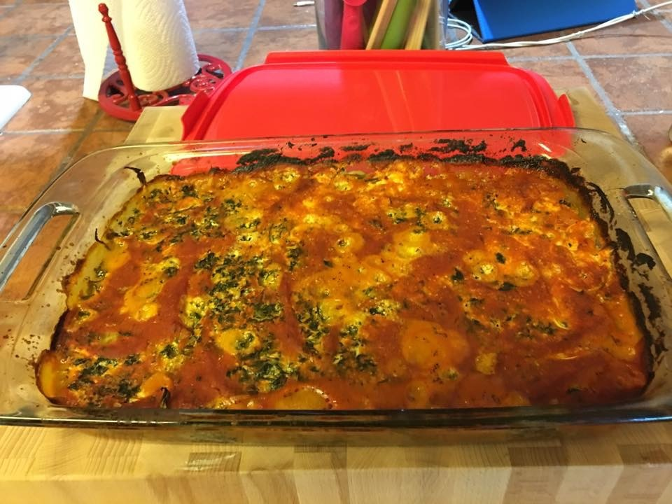 Spinach and cheese with zucchini noodles in a red sauce