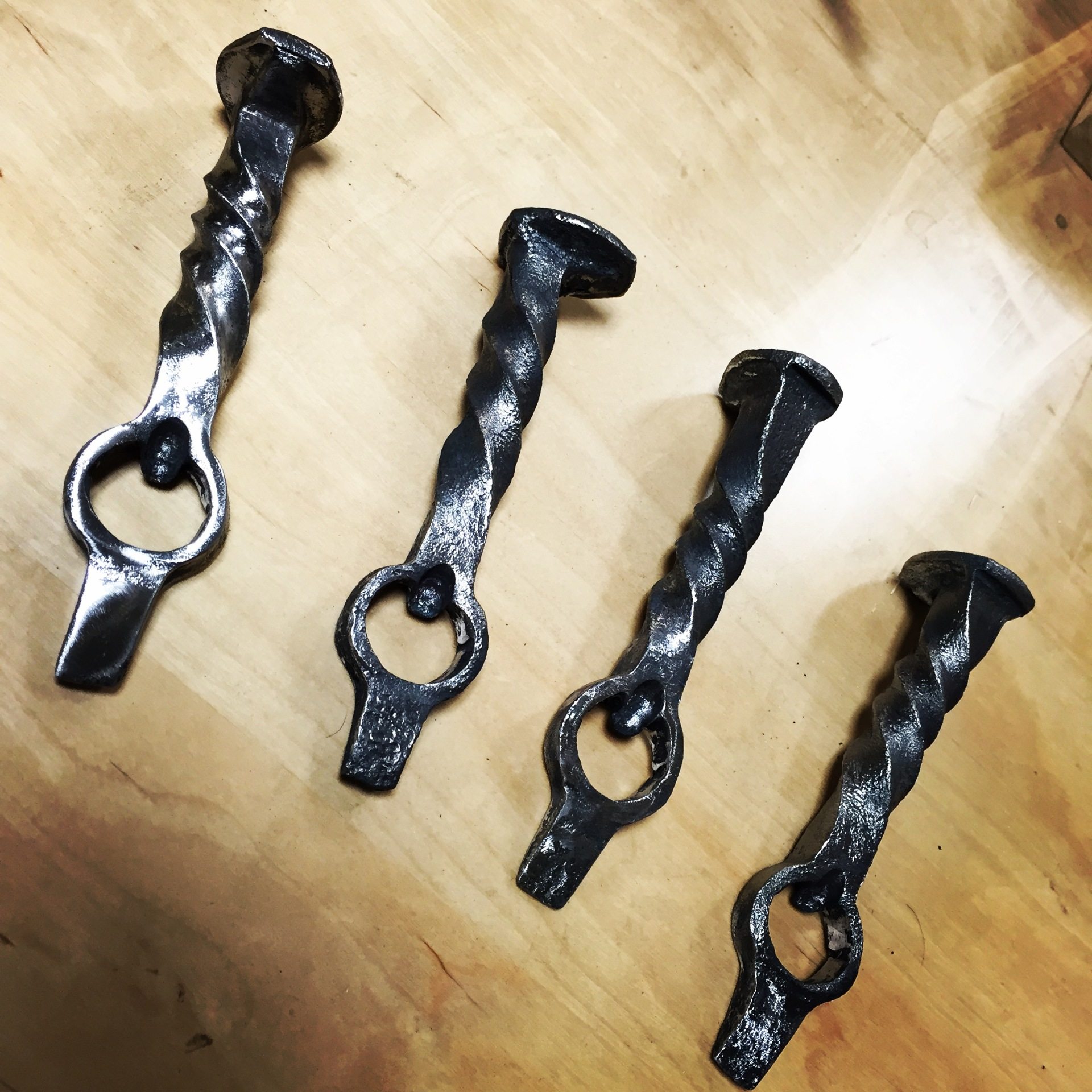 Finished products: Railroad spike bottle openers
