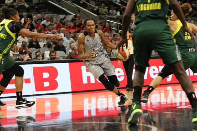 San Antonio Stars' Monique Currie (1) dribbles the ball through the Seattle Storm's defense. (Anthony Mazur/AM News Net)