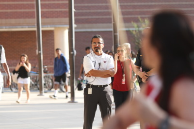 Coppell High School principal Mike Jasso watches as a crowd protests outside of the school after an alleged sexual assault of a student with Aspergers' Syndrome on May 31, 2017. (Anthony Mazur/AM News Net)