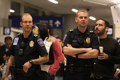 Policemen stand guard outside Terminal D during a protest at D/FW airport on January 29, 2017 in response to an executive order from President Trump restricting immigration from seven predominantly Muslim countries. (Anthony Mazur/AM News Net)