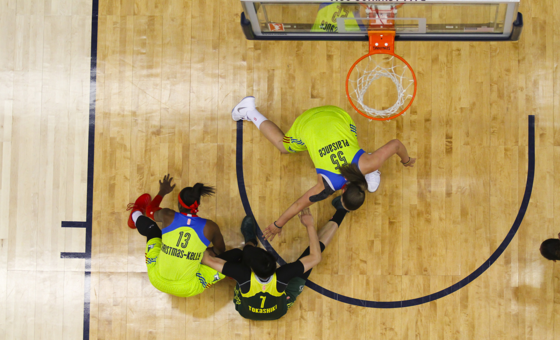 August 4, 2017 - Arlington, TX - Seattle Storm's Ramu Tokashi (7) and the Dallas Wings' Karima Christmas-Kelly (13) and Theresa Plaisance (55) fight over the ball in the game between the Dallas Wings and Seattle Storm. (Anthony Mazur/AM News Net)
