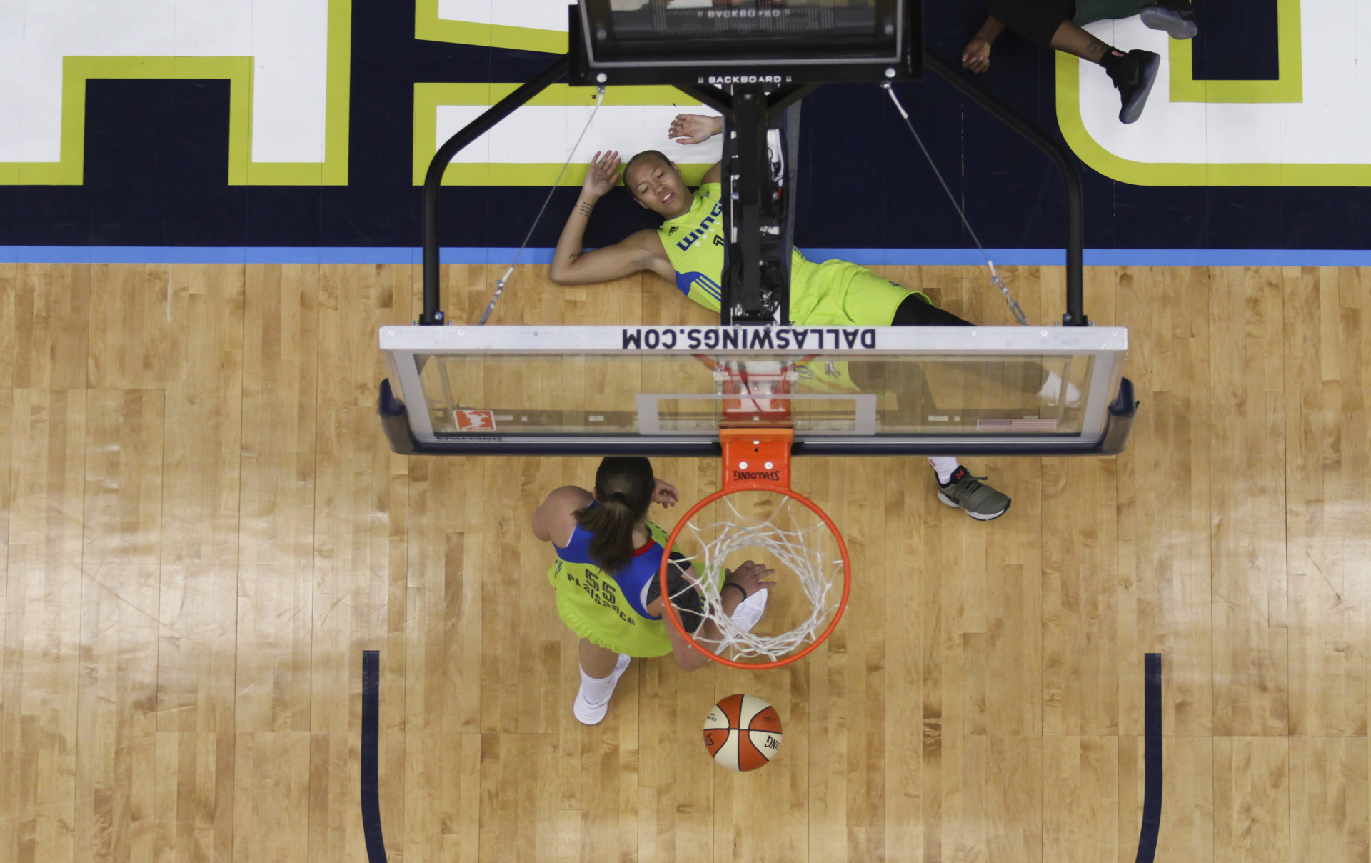 August 4, 2017 - Arlington, TX - The Dallas Wings' Theresa Plaisance goes to help up a fallen teammate in the game between the Dallas Wings and Seattle Storm. (Anthony Mazur/AM News Net)