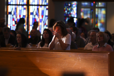 IRVING, TX - OCTOBER 6: A woman prays before Friday mass at St. Monica Catholic Church on October 6, 2017. (Anthony Mazur/AM News Net)