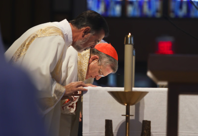 IRVING, TX - OCTOBER 6: Cardinal Raymond Burke kisses the altar during Friday mass at St. Monica Catholic Church on October 6, 2017. (Anthony Mazur/AM News Net)