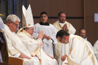 IRVING, TX - OCTOBER 6: Cardinal Raymond Burke blesses a priest during Friday mass at St. Monica Catholic Church on October 6, 2017. (Anthony Mazur/AM News Net)