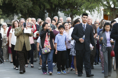 IRVING, TX - OCTOBER 6: People walk through the parking lots for a Rosary procession after Friday mass at St. Monica Catholic Church on October 6, 2017. (Anthony Mazur/AM News Net)