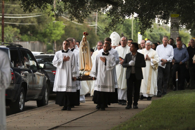 IRVING, TX - OCTOBER 6: People walk in a Rosary procession after Friday mass at St. Monica Catholic Church on October 6, 2017. (Anthony Mazur/AM News Net)