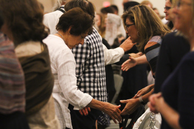 IRVING, TX - OCTOBER 7: People give the sign of peace to others during mass at the Fatima Summit at the Irving Convention Center on October 7, 2017. (Anthony Mazur/AM News Net)