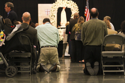 IRVING, TX - OCTOBER 7: Men pray during the mass at the Fatima Summit at the Irving Convention Center on October 7, 2017. (Anthony Mazur/AM News Net)