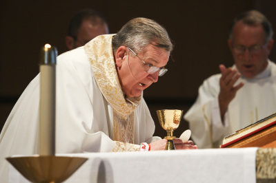 IRVING, TX - OCTOBER 6: Cardinal Raymond Burke consecrates the Eucharist during Friday mass at St. Monica Catholic Church on October 6, 2017. (Anthony Mazur/AM News Net)